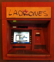 Near the stadium left-leaning locals have daubed a cashpoint. 'Ladrones' means 'thieves'