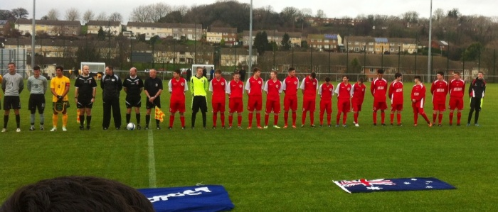 The Welsh team line up before the match