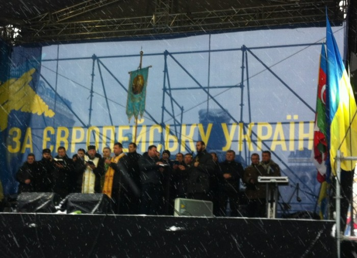 Ukrainian Orthodox Church priests conduct a service on the stage in the main square