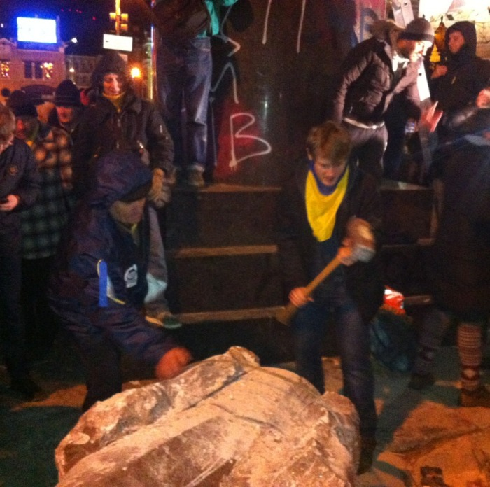 Lenin gets a further battering from a sledgehammer-wielding protester