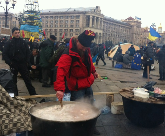 A soup tureen is stirred in the Independence Square  encampment