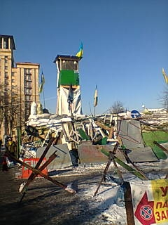 A watchtower has been erected overlooking a protesters' barricade in central Kyiv
